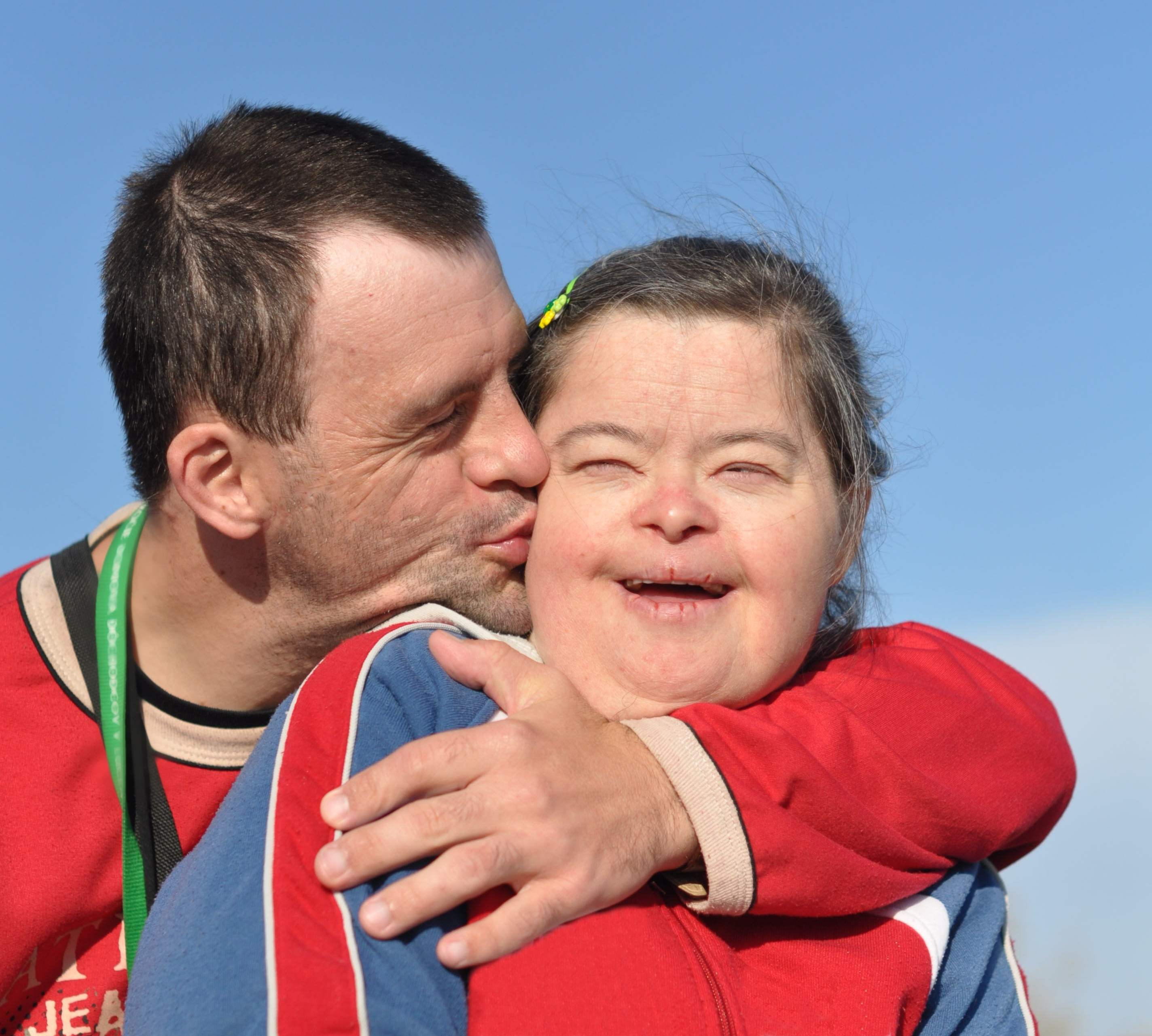 Man and woman with down syndrome kissing